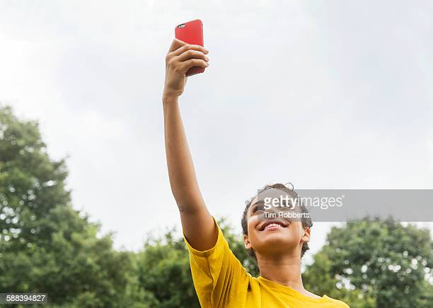 Woman with smart phone in air.