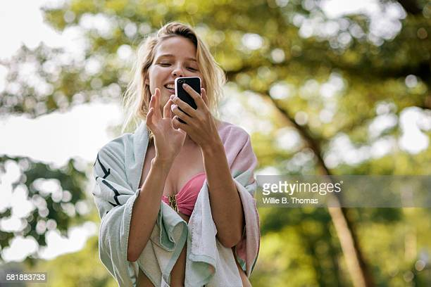 Woman with smart phone texting