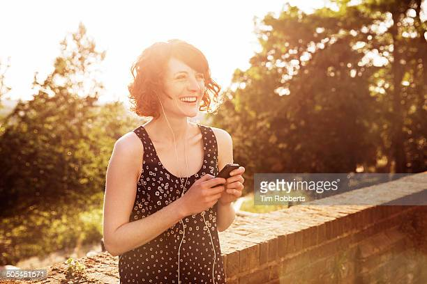 Woman with smartphone and headphones.