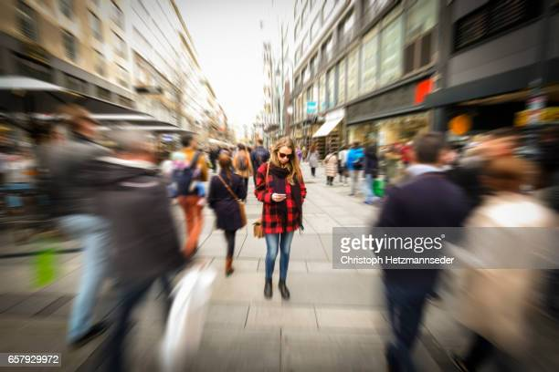 woman with smartphone - motion blur stock photos and pictures