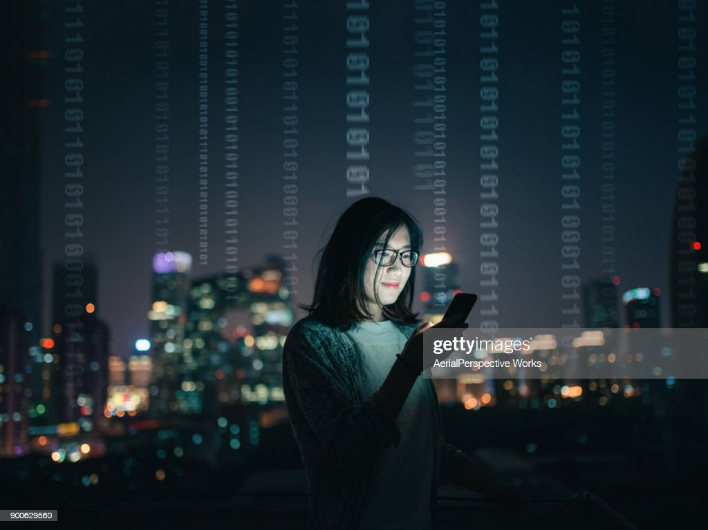 Woman with Smartphone Standing on Skyscraper Roof : Stock Photo
