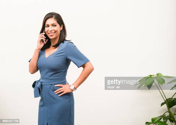 Woman with smile on her face on phone.