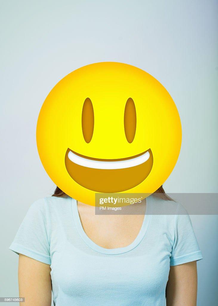 Woman with smiling emoji head : Stock Photo