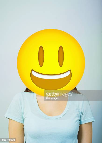woman with smiling emoji head - smiley face stock pictures, royalty-free photos & images