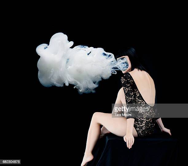 woman with smoke coming our of face