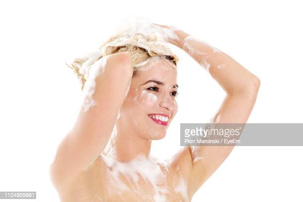 woman with soap sud against white background - washing hair stock pictures, royalty-free photos & images