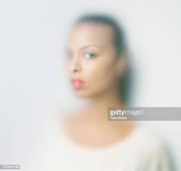 woman with soft focus looking through glass - defocussed stock pictures, royalty-free photos & images