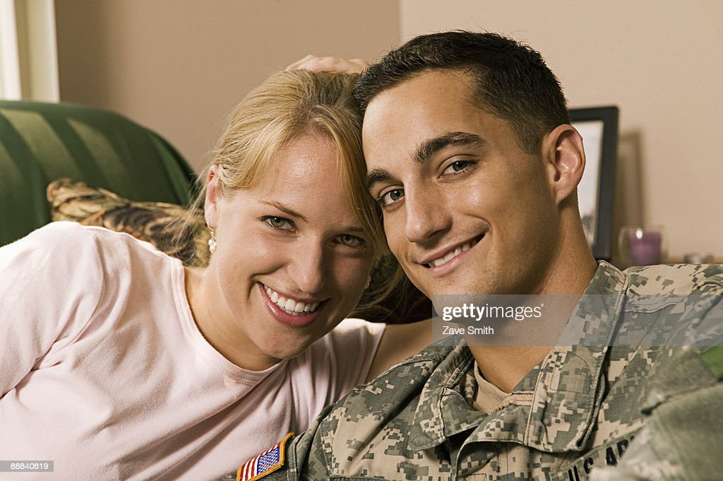 Woman with soldier at home : Stock Photo