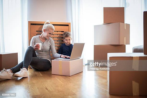 Woman with son in new apartment