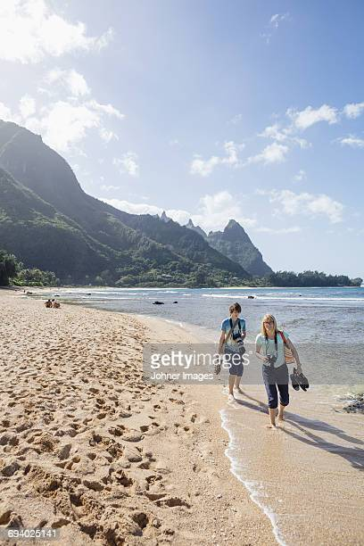 Woman with son walking on beach