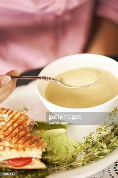 Woman with soup and sandwich