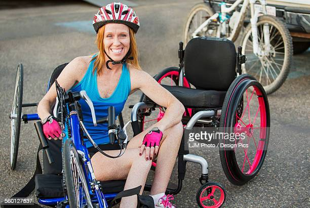 woman with spinal cord injury cycling using hand propelled bicycle - paraplegic stock photos and pictures