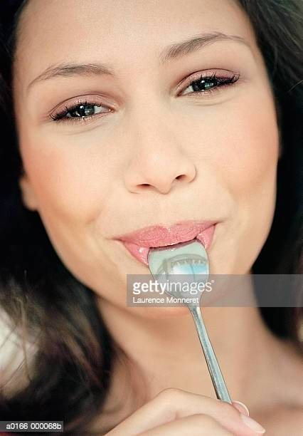 Woman with Spoon in Mouth