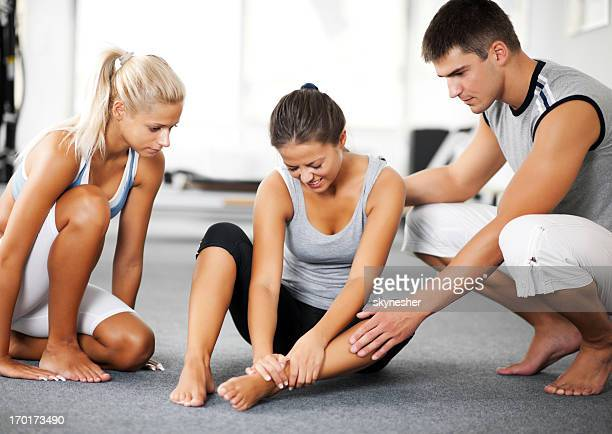 Woman with sprained ankle and her two friends