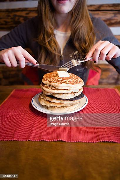 Woman with stack of pancakes