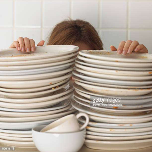 Woman with stacked dishes