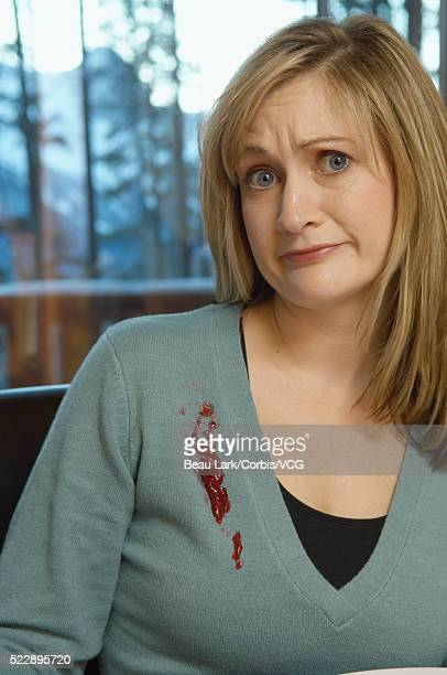 woman with stain on sweater - irony stock pictures, royalty-free photos & images