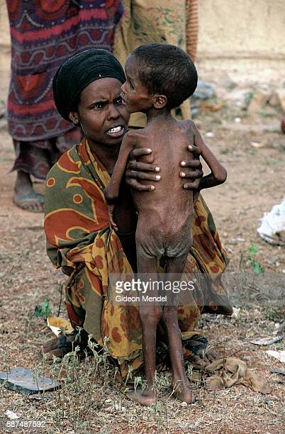 Woman with Starving Child