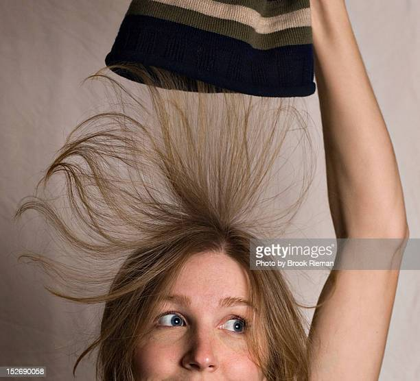 Woman with static-cling hat hair