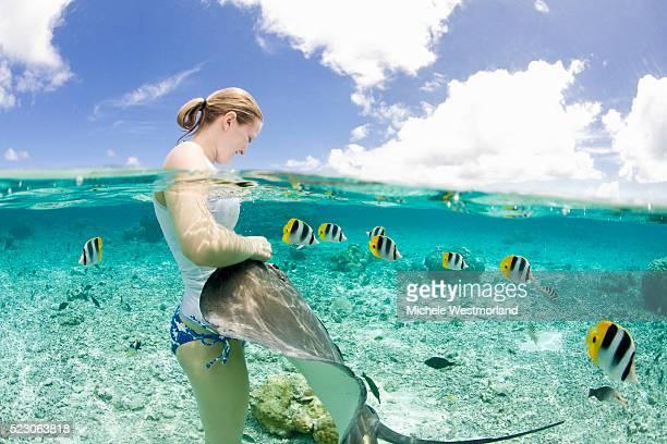 Woman With Stingray in Bora-Bora Lagoon