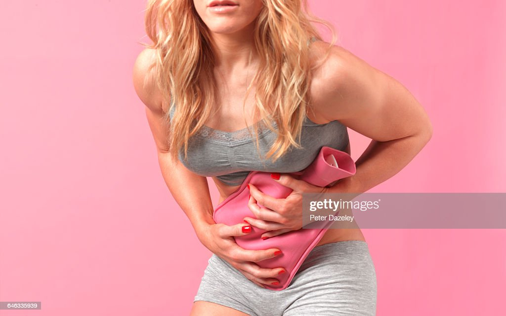 Woman with stomach cramps : Stock Photo
