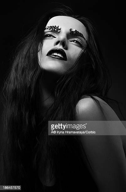 Woman with Strass over Black background