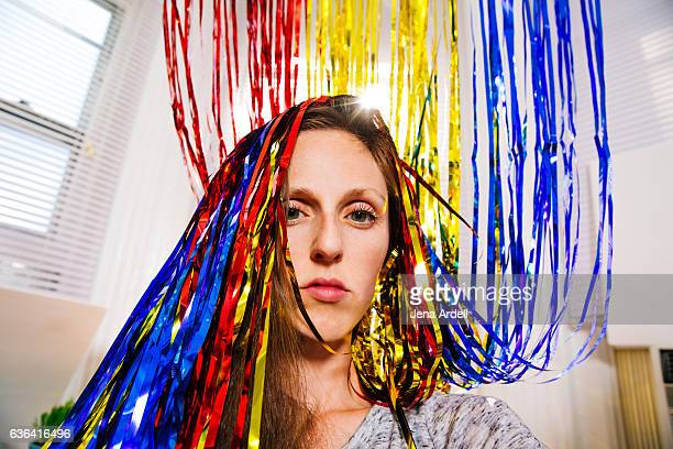 woman with streamers in her hair - hangover after party stock pictures, royalty-free photos & images
