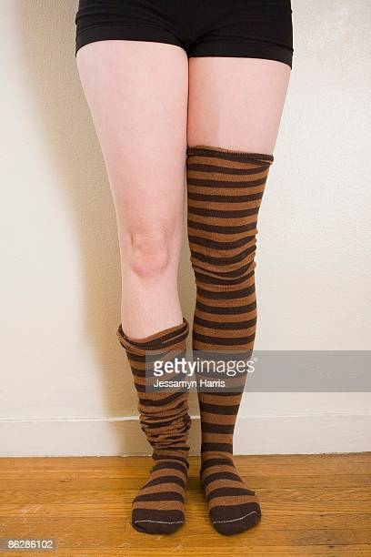 woman with striped leggings - drooping stock photos and pictures
