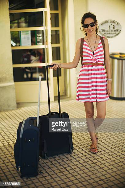 Woman with suitcases in train station