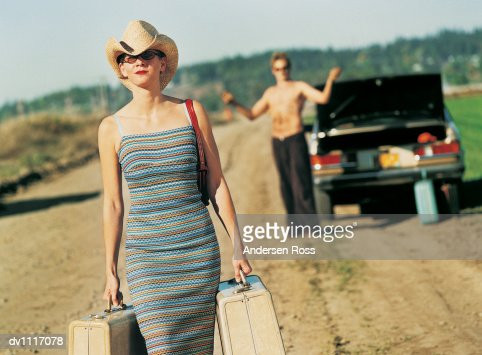 man walking away from a woman woman with suitcases walking away from a man standing by a 846