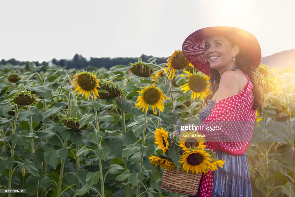 Woman with sunflowers : Stock Photo