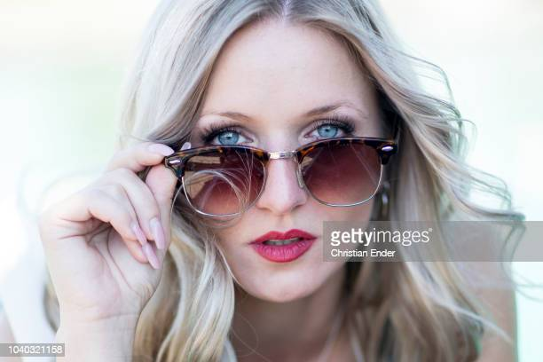 woman with sunglasses - hot high school girls stock photos and pictures