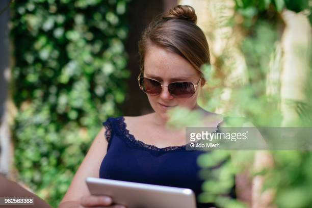 Woman with sunglasses using tablet pc.