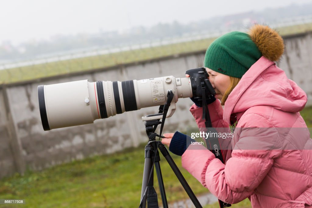 Woman With Super Telephoto Lens In Kiev Airport Ukraine