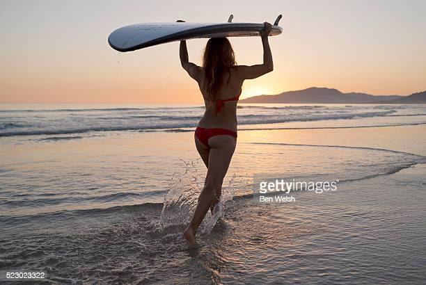 Woman with surf board.