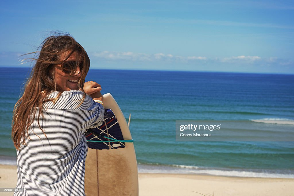 Woman with surfboard on beach, Lacanau, France : Stock Photo