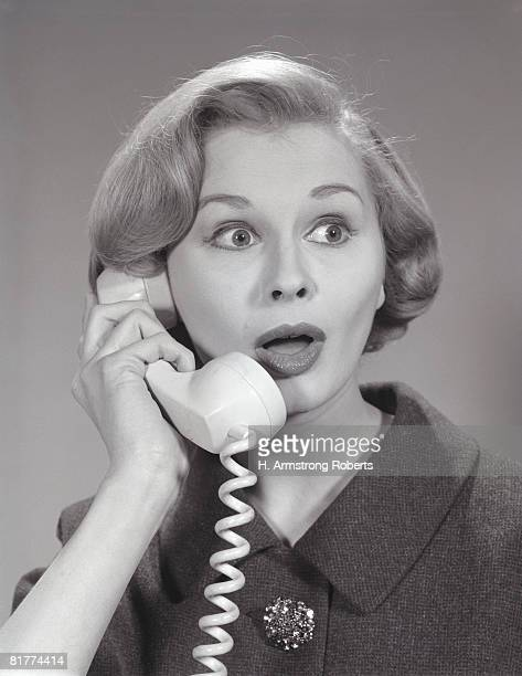 Woman with surprised expression, on telephone. (Photo by H. Armstrong Roberts/Retrofile/Getty Images)