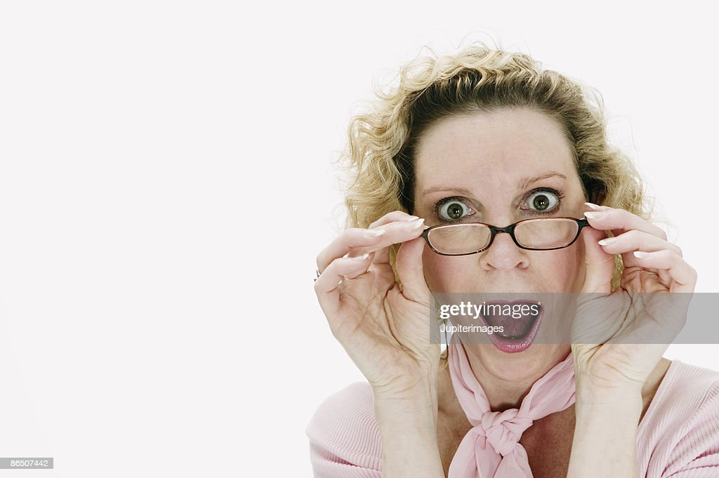 Woman with surprised expression : Stock Photo