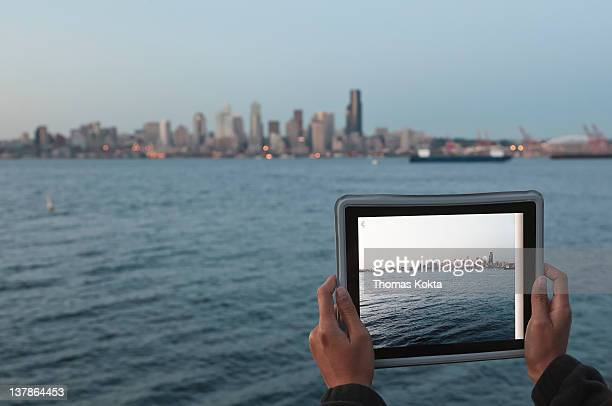 Woman with tablet computer and Seattle skyline