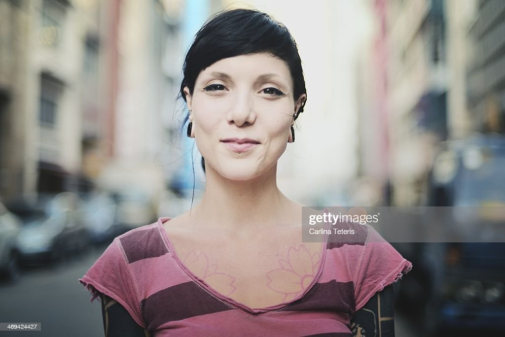 Woman with tatoos on the street : Stock Photo