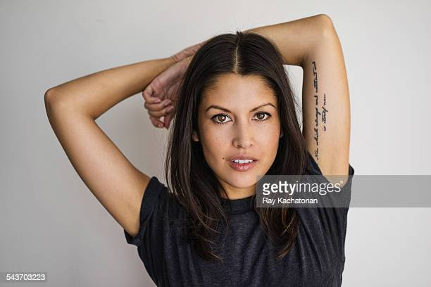 woman with tattoo arms over head portrait - medium length hair stock pictures, royalty-free photos & images