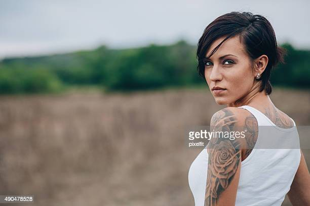 woman with tattoo - tattoo stock pictures, royalty-free photos & images