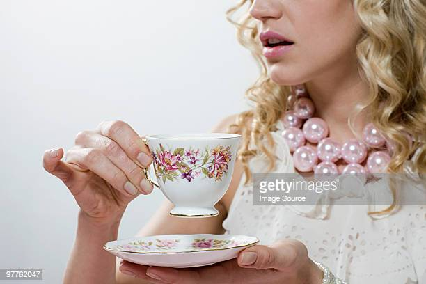 woman with tea - saucer stock pictures, royalty-free photos & images