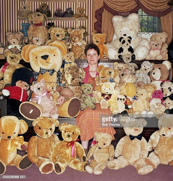 Woman with teddy bear collection, portrait