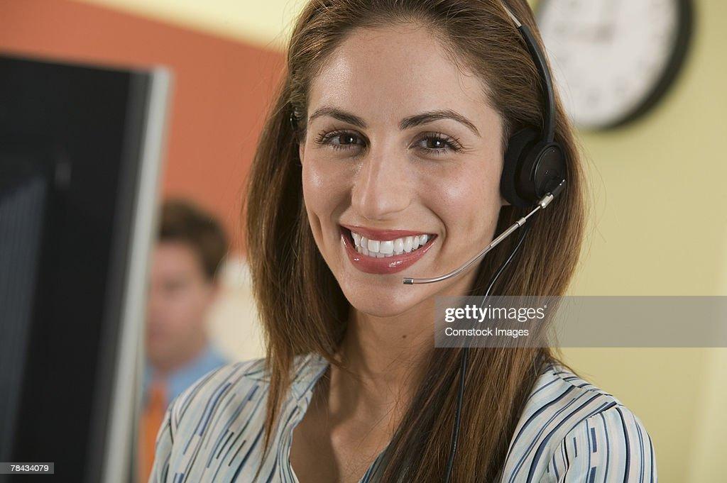 Woman with telephone headset : Stockfoto