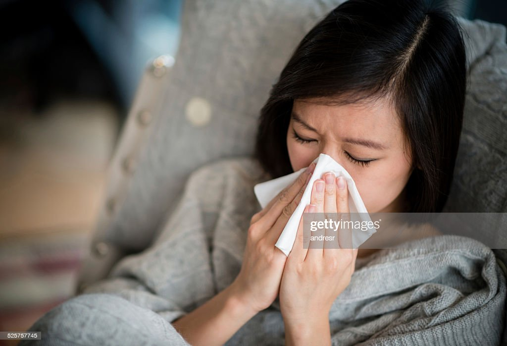 Woman with the flu : Stock Photo
