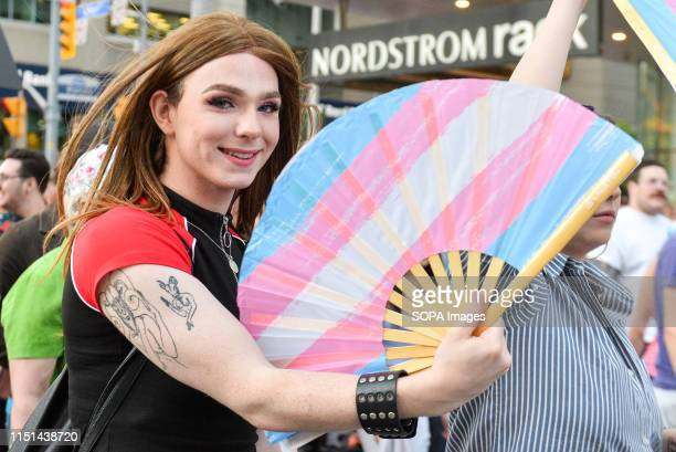 STREET TORONTO ONTARIO CANADA A woman with the LGBT fan during the Trans march Spectators displayed their support towards the transgender and...
