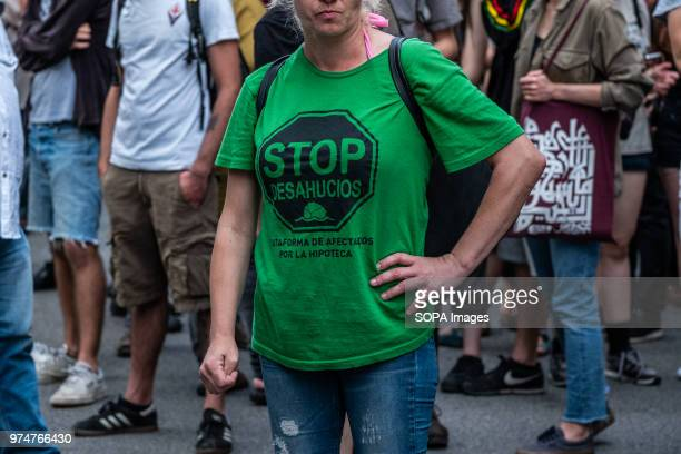 A woman with the traditional green shirt of STOP evictions is seen during the protest Hundreds of people demonstrated before the Department of...