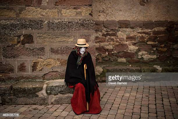 A woman with their faces covered with a mask know as 'Mascarita' join a carnival festival on February 14 2015 in Luzon Spain Every year Luzon hosts...