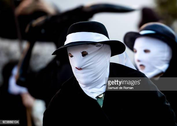 A woman with their faces covered with a mask know as 'Mascarita' join a carnival festivalin Luzon near Guadalajara on February 24 2018 in Guadalajara...